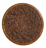 Carved circular wood panel with floral design. Isolated Royalty Free Stock Images