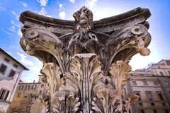 Carved Column, Florence, Italy. Carved Column with blue skies in background, Florence, Italy Royalty Free Stock Image