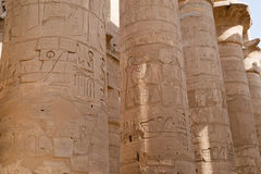 Carved columns in Luxor. Carvings on stone columns in ancient Luxor, Egypt Stock Images