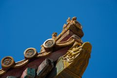 Carved cornerpiece of traditional chinese roof stock photography