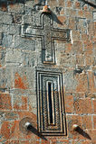 Carved cross in stone. Detail on the wall of an abandoned Georgi Stock Photos