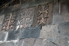 Carved crosses in a row on the wall of Geghard monastery Stock Photography