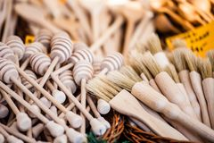 Carved cups, spoons, forks and other utensils of wood Stock Photo