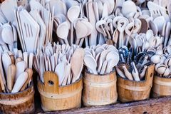 Carved cups, spoons, forks and other utensils of wood Royalty Free Stock Image