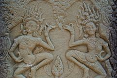 Carved dance. Two aspara dancers carved into the stone of bayon temple angkor Royalty Free Stock Image