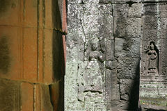 Carved devatas. Carved female deity on the wall of Angkor Stock Images
