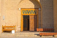 Carved doors in ancient Muslim mausoleum, Bukhara. Carved doors in Ancient Muslim Mausoleum of Sayf al-Din Bahorzi, Shaikh, poet and theologian of the Middle Royalty Free Stock Image