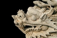 Carved dragon. On black background Stock Photos