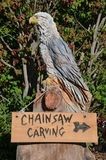 Carved eagle advertises site of wood carvings Stock Photo