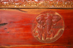 Carved Elephant. Elephant carved in a red piece of wood Royalty Free Stock Photo