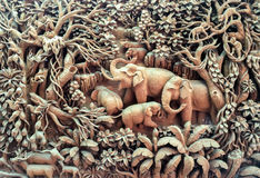 Carved Elephant Family in The Wood on The Wooden Frame Royalty Free Stock Images