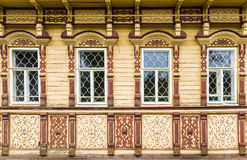 Carved facade of a wooden house Stock Photography