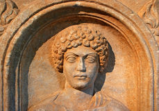 Carved face. Close up of a stone carved face Royalty Free Stock Photo