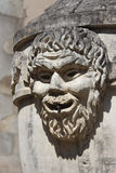 The carved face of a man decorates a fountain (France) Royalty Free Stock Image