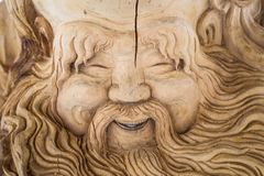 carved face of an old man made from a tree, Tomsk, Russia 2018-04-01 stock images