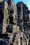 Carved face in wall in Angkor Wat royalty free stock photography