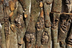Carved Faces in Wood Stock Images