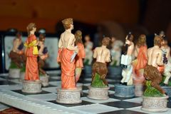 Carved wooden figured game chess. Children play original exclusive chess stock photography