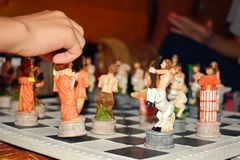 Carved figured game wooden chess. Children play original exclusive chess stock image