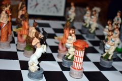 Carved figured game wooden chess. Children play original exclusive wooden chess stock images