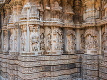 Carved Figures on a Hindu Temple. Intricately carved figures on a wall at the 13th Century temple of Somanathapur, South India Royalty Free Stock Photography