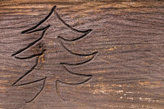 Carved fir tree in weathered wood Stock Photography