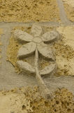 Carved flower. An artistic flower sculptured on a wall in Naples Stock Photo