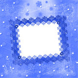Carved frame for photo. On the abstract blue background Royalty Free Stock Photo