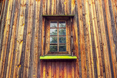 Carved frame and window in the old wooden house from boards Stock Images