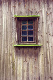 Carved frame and window in the old wooden house from boards Royalty Free Stock Image