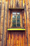Carved frame and window in the old wooden house Stock Photo