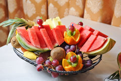 Carved fruits arrangement. Fresh various fruits. Assortment of exotic fruits. Stock Photos