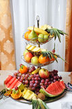 Carved fruits arrangement. Fresh various fruits. Assortment of exotic fruits. Royalty Free Stock Photography