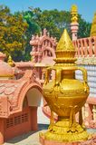 Golden vase decorates the roof of the shrine of Sitagu International Buddhist Academy pagoda, Sagaing, Myanmar. The carved golden vase decorates the roof of the stock photo