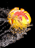 Carved grapefruit in a stream of water Stock Images