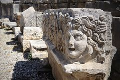 Carved Greek mask of Greco-Roman amphitheatre, Myra, Turkey. Carved Greek mask, a fragment of decoration of the Greco-Roman amphitheatre, Myra, Turkey royalty free stock photography