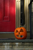 Carved Halloween Pumpkin. Close up of an orange, carved, october Halloween pumpkin or jack o'lantern on doorstep of house stock images