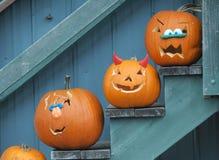 Carved Halloween pumpkins on display stock images