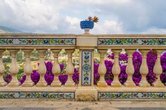 Carved handrail with ceramic pattern and surmounted by a blue ba Stock Photo