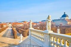The carved handrails with carved sculptures in Belvedere Garden, Vienna, Austria. VIENNA, AUSTRIA - FEBRUARY 18, 2019: The handrails of Belvedere Garden are stock image
