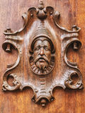 Carved head. Of a man on a wooden door Royalty Free Stock Photo