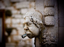 Carved head shaped old stone Royalty Free Stock Photography
