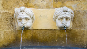 Carved Heads Fountain Royalty Free Stock Image