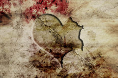 Carved heart on ground. Old and fracture wall with carved heart Royalty Free Stock Photo