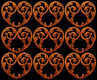 Carved Hearts. Delicate gothic wooden hearts isolated on a black background Royalty Free Stock Photo