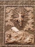 Carved icon for luck. A carved icon of resurrection and twelve major feats stock photo