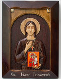 Carved icon from wood handmade. Holy timothy royalty free stock image