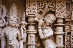 Carved idol on the inner wall of Rani ki vav, an intricately constructed stepwell on the banks of Saraswati River. Patan, Gujarat stock photo