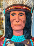 Native Indian Chief Carved Head Statue. Outside a small southwest town smoke shop is this freshly painted carved Indian head royalty free stock photos