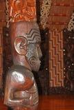 Carved interior of Maori meeting house stock photos